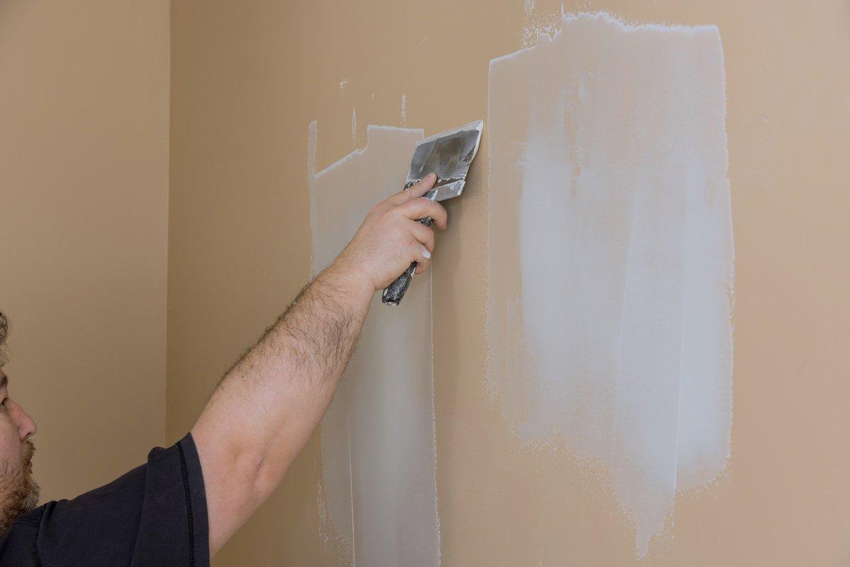bigstock-Plasterer-Plastering-A-Wall-Of-410084293.jpg