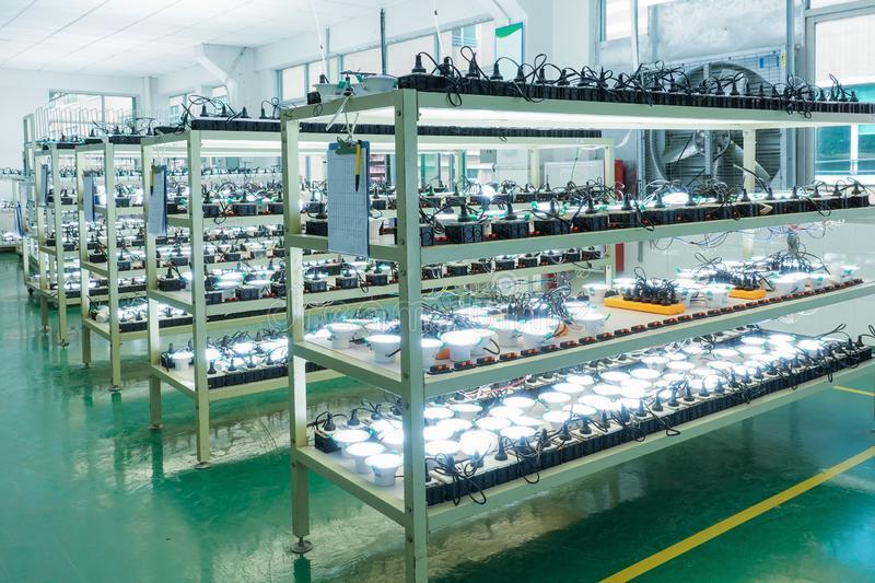 led-light-bulb-factory-energy-saving-product-rack-146836313.jpg